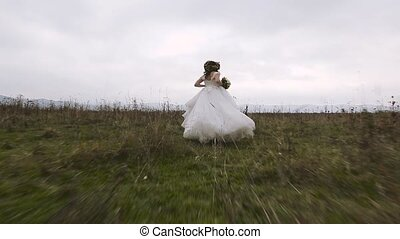 Bride from the Groom Runs - Stedicam shot. Bride from the...