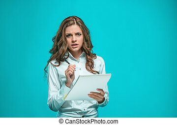 The thoughtful young business woman with pen and tablet for...