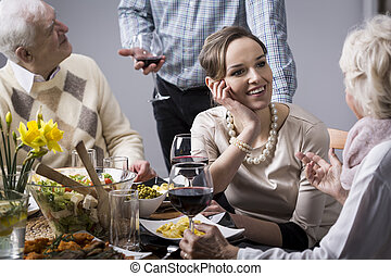 Woman chatting at the dinner table - Young, elegant woman...