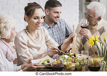 Woman with family at dinner table