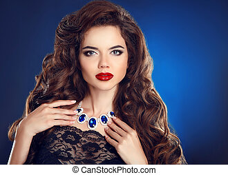 Brunette girl with long shiny wavy hair and red lips makeup,...