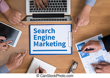 Search Engine Marketing Business team hands at work with...