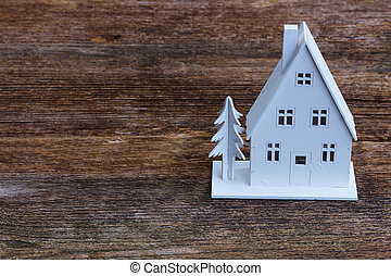 White christmas house on wooden texture background...