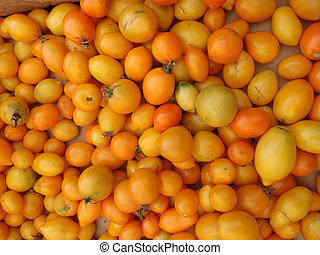 Bunch of Yellow-Orange small Tomatoes