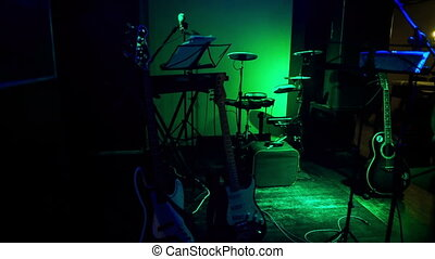 Musical Instruments on Night Bar Stage under Light Flashes -...