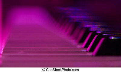 Closeup Electric Piano Keys under Flashes of Colourful Lights