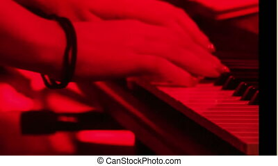 Closeup Girl Plays Piano in Night Bar under Light Flashes -...