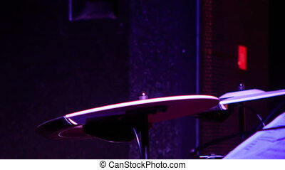 Closeup Drummer Plays on Plates in Night Bar under Flashes -...