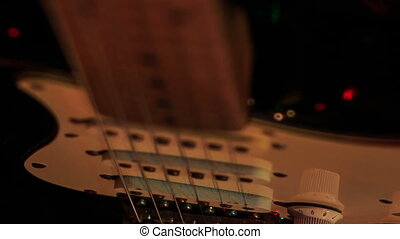 Closeup Guitar Finger-board in Night Bar under Light Flashes...