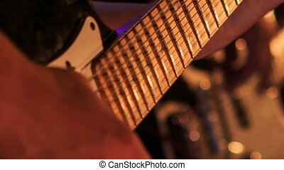 Closeup Guitarist Touches Strings on Finger-board in Night...