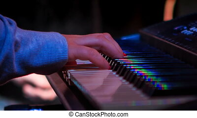 Girl Plays Electric Piano in Night Bar under Light Flashes -...