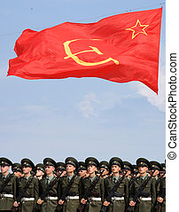 solgers under the soviet flag - Soldiers armed with...