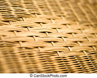 Woven rattan - A close up of a woven rattan pattern