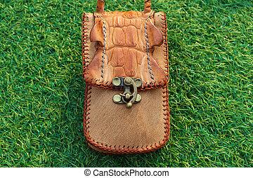 pocket of leather crocodile skin