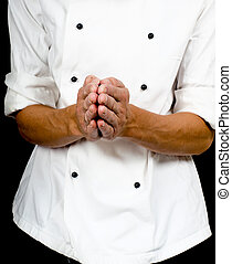 Professional chef with a hand gesture towards, wearing a...