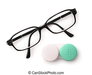 Top view of eyeglasses and eye contact lenses isolated on...