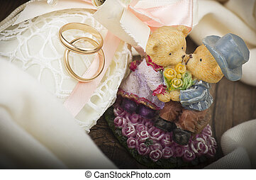 Wedding Rings with Wedding Decoration on the wood