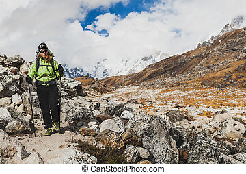 Woman hiking in Himalaya Mountains on Rocky Trail
