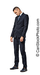 Full growth portrait of businessman standing with bowed head...
