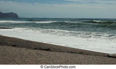camera moves along the coast