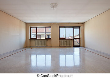 Empty living room with marble floor
