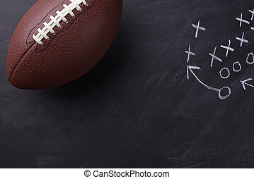 American Football on Chalkboard - Top view of an American...