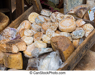 Natural artisan mountain cheeses with mold on rind - Group...