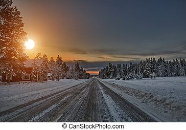 Sunset over road, Lapland Finland - Sunset over scenic road,...