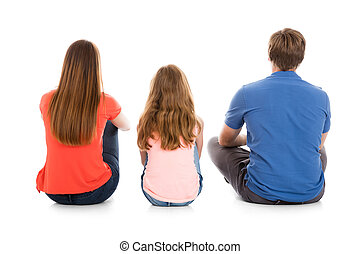 Family Sitting On White Background - Rear View Of A Family...