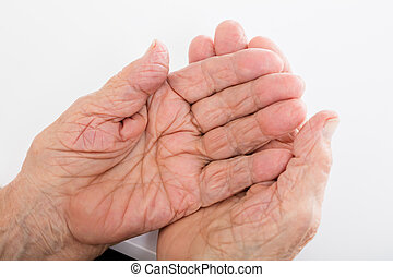 Senior Woman Hand On Desk - Close-up Of Senior Woman Hand On...