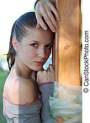 Young girl - Beautiful girl with a bare shoulder, leaned...