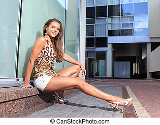 Beautiful woman near shop show-window - Beautiful brunette...