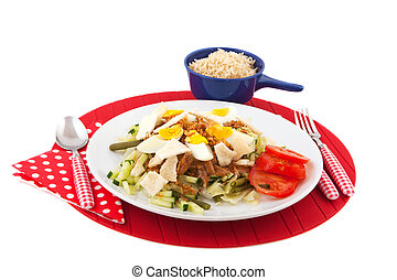 Indonesian food Gado Gado with brown rice isolated over...