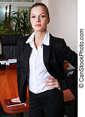 businesswoman in black suit - Young attractive businesswoman...
