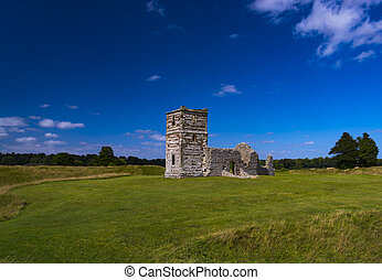 Late summer sunshine on the medieval Knowlton Church,...