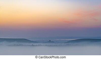 Rainbow skies in the Dorset Purbeck Hills above Corfe Castle...