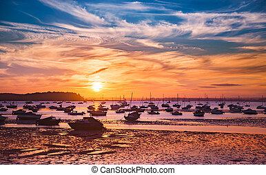 Serene sunset over boats at Sandbanks, Poole, Dorset near...