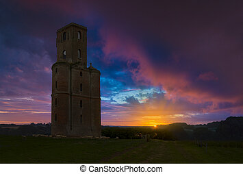 Horton Tower, a folly in East Dorset at sunset - Sheep...
