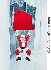 Santa Claus trains to lift very heavy bag with gifts in an...