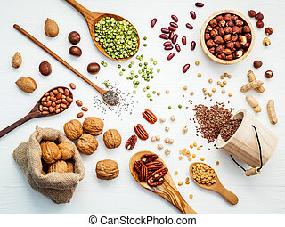 Bowls and spoons of various legumes and different kinds of...