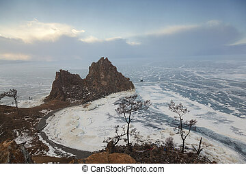 Shaman rock and cape Burhan on Olkhon Island, Russia - View...