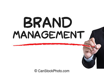 BRAND MANAGEMENT Businessman hand writing with black marker...