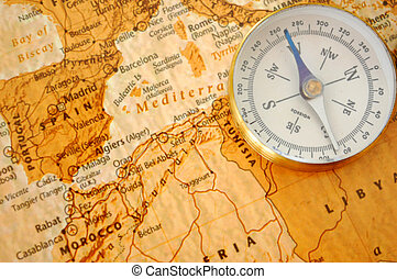 Compass on a map - Vintage compass on an old map