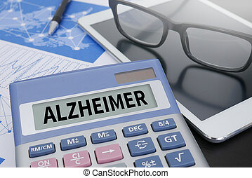 ALZHEIMER Calculator  on table with Office Supplies. ipad