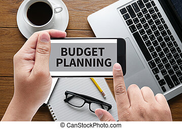 BUDGET PLANNING message on hand holding to touch a phone,...