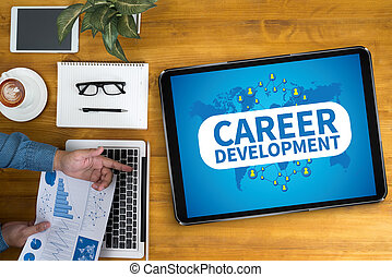 CAREER DEVELOPMENT Businessman working at office desk and...