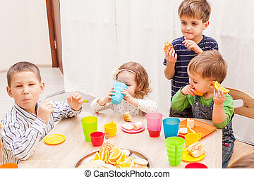 Happy birthday party - Group of happy children enjoying...