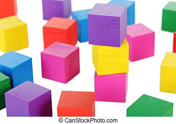Colorful wooden toy cubes on a white background