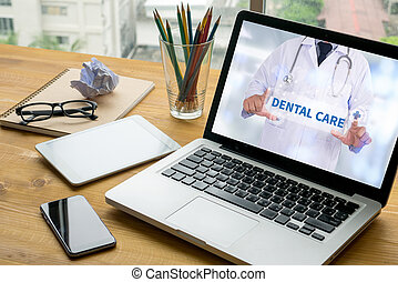 DENTAL CARE Laptop on table. Warm tone