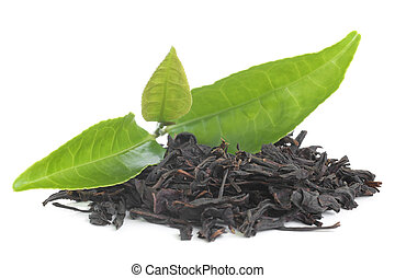 Black tea with green leavas on white background